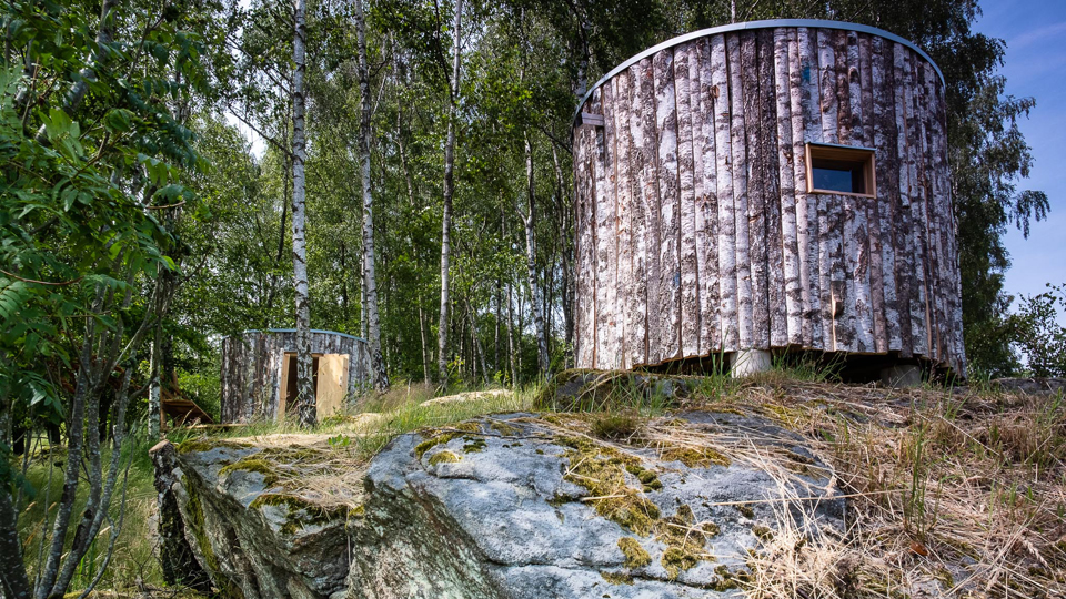 Two of the unique wind shelters at Hovdala which are nicely embedded in a birch grove.