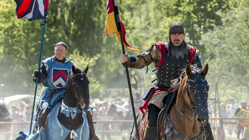 Two knights with their horses in a tournament at Hovdala castle.